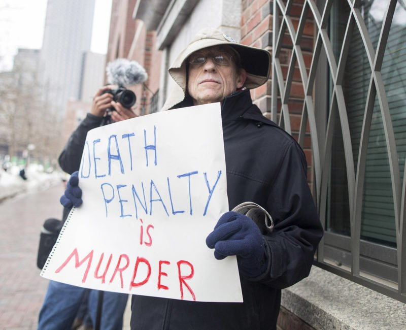 © Getty images. Protester holds a sign that reads
