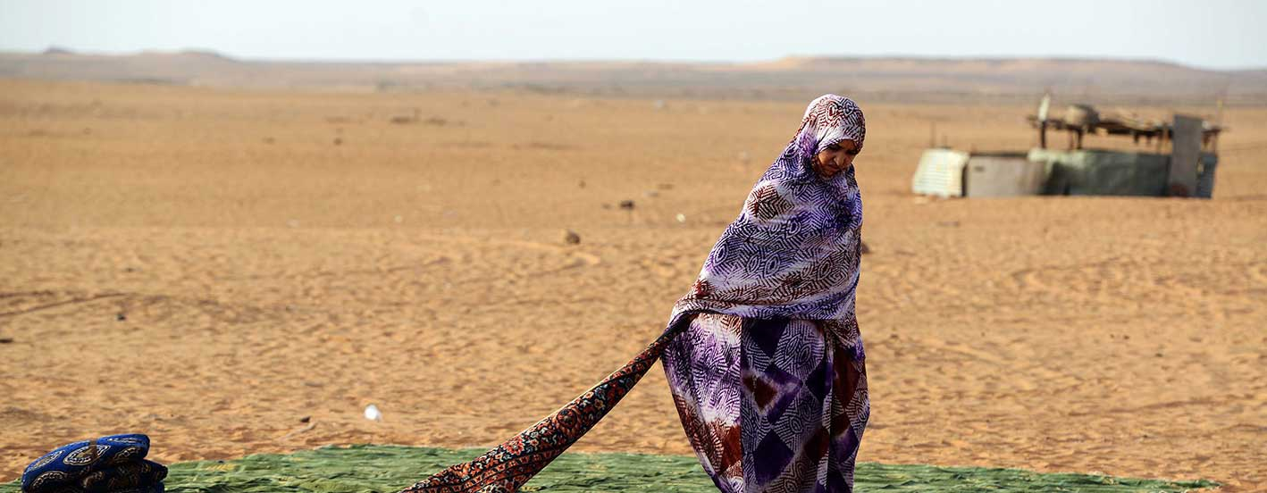 A Sahrawi refugee stands on a rug at the Sahrawi refugee camp of Dakhla