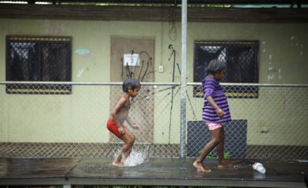 Two indigenous kids at play in their community