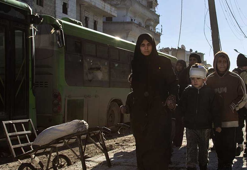 Syrians gather during an evacuation operation of rebel fighters and their families from rebel-held neighbourhoods