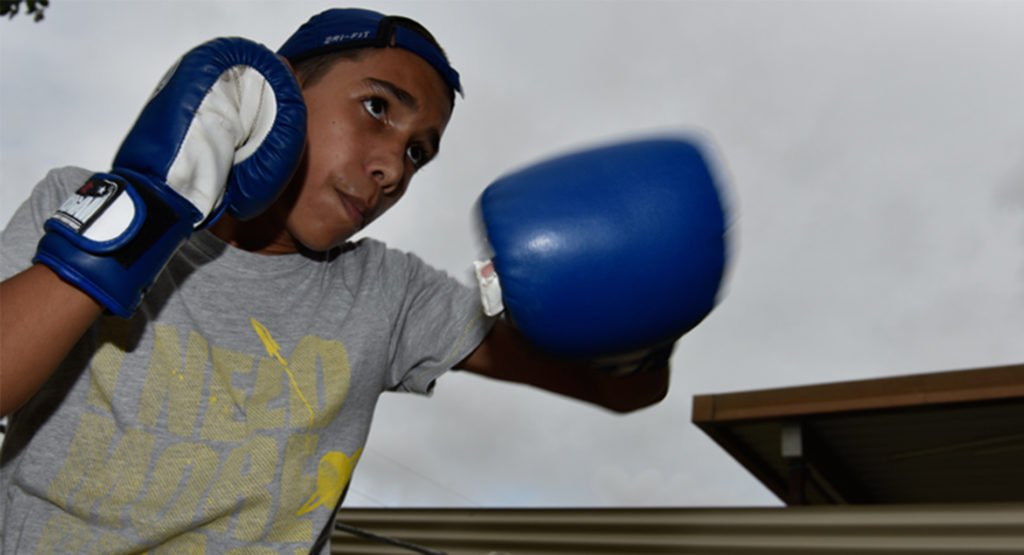 12-year-old Wayne Parker Junior loves boxing with his grandad. © Wayne Quilliam