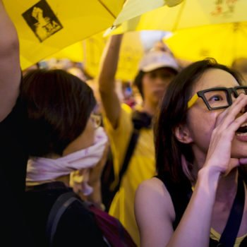 A pro-democracy protester shouts during a rally outside government headquarters in Hong Kong