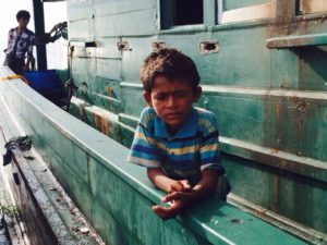 Rohingya child on boat at sea