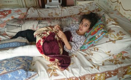 Ghina Ahmad Wadi, a young girl lying in bed