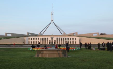 A display of hands planted in the lawns in front of Parliament House in protest of Aboriginal deaths in custody