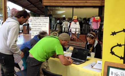 People sign up to the No Business in abuse campaign in Margaret River, WA.