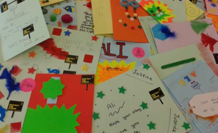 Solidarity cards made by school children for Ali Ozdemir, a Syrian national who was shot in the head and blinded at 14 years old when he approached the Turkish border. © Amnesty International
