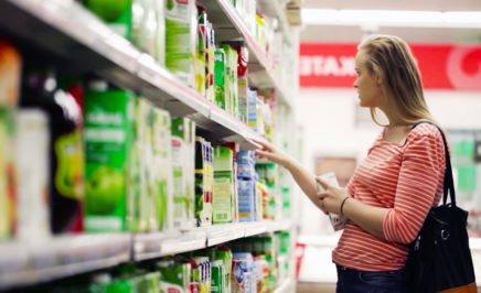 A woman shopping inside a supermarket.