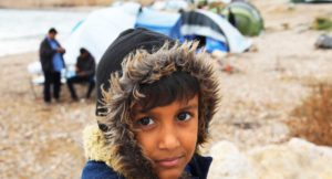 Young boy in a refugee camp in Greece