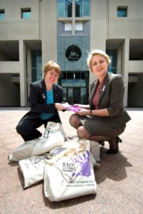 Tanya Plibersek receives Amnesty International Australia's petition from Claire Mallinson outside Parliament in November 2008.