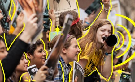 A young women protests at a rally. The women are outlined by yellow lines.