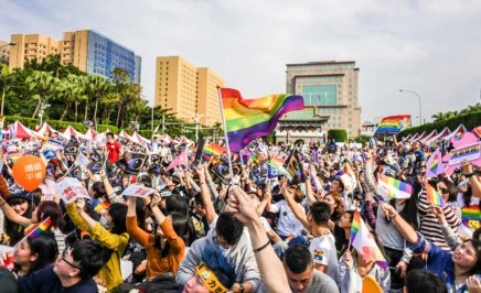 Thousand People waving rainbow flags in Front of the Presidential Office Building of Taiwan
