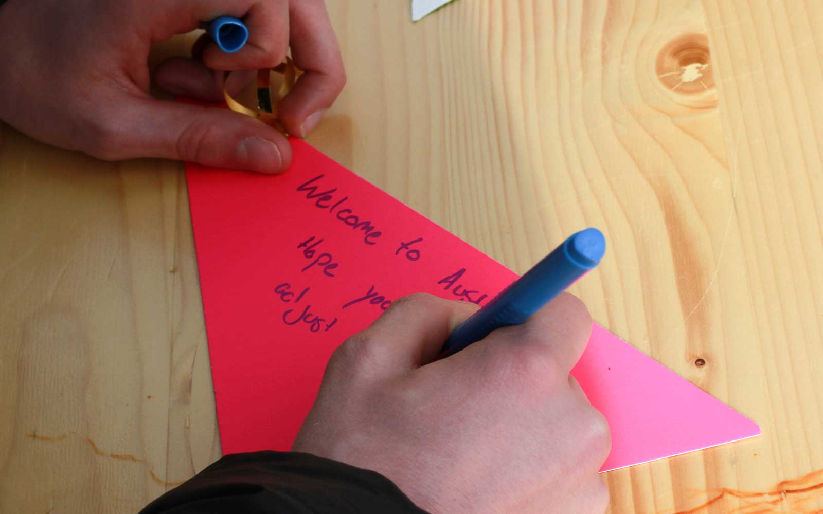 A passer-by writing a message of welcome