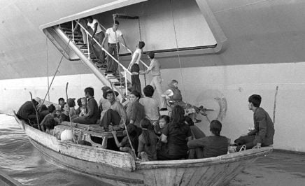 Vietnamese refugees prepare to come aboard the USS BLUE RIDGE