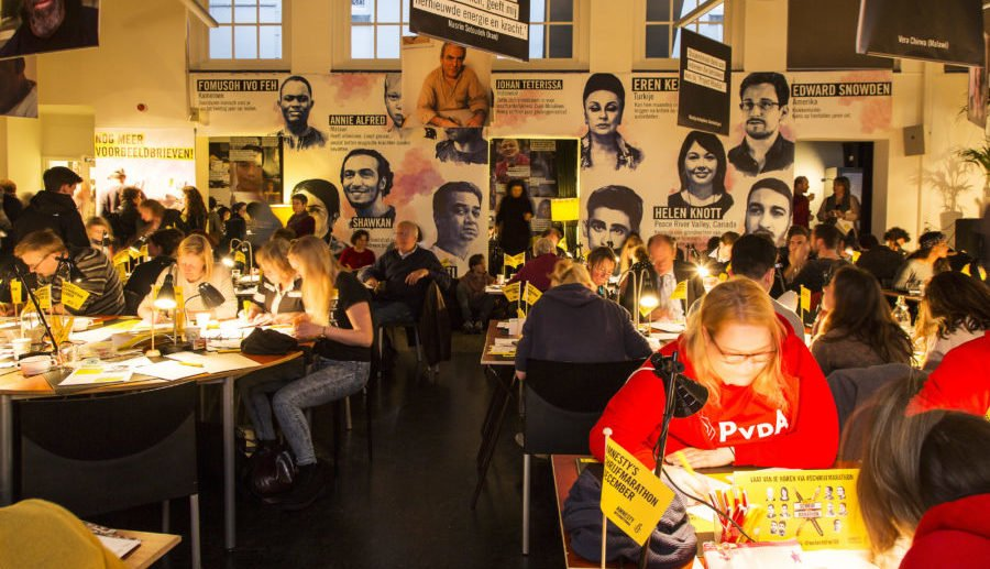 Dutch activists participate in a Write for Rights letter writing marathon to mark International Human Rights Day, where hundreds of thousands of people around the globe take part in the world's largest human rights event: Write for Rights.