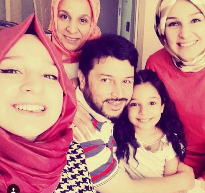Taner Kilic, the Chair of Amnesty International Turkey, with his daughters and wife.