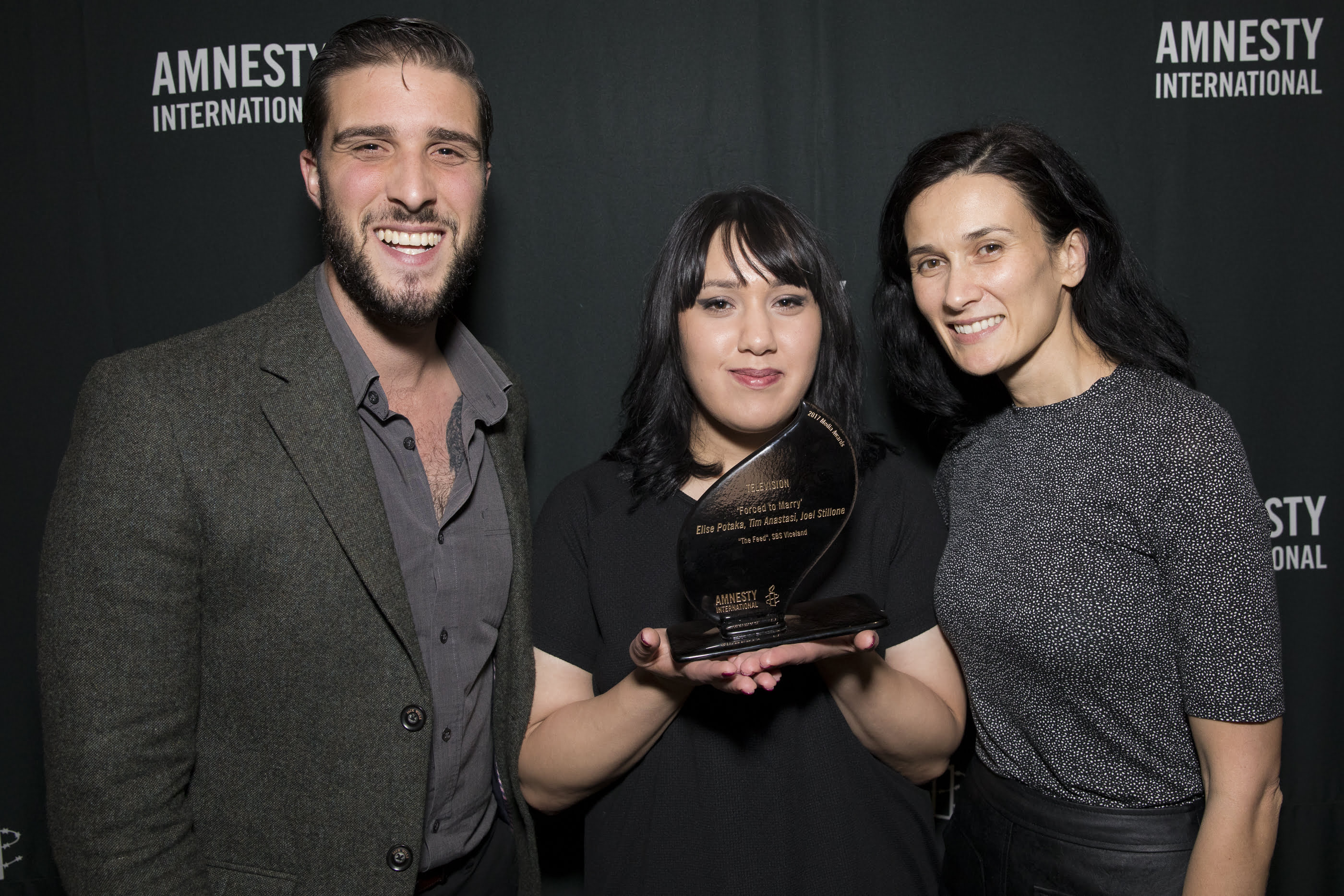 Elise Potaka, Tim Anastasi and Joel Stillone take home the 2017 Amnesty International Media Award for the category of Television. They are joined by Bee [middle] who shared her family's story. © Joseph Mayers Photography