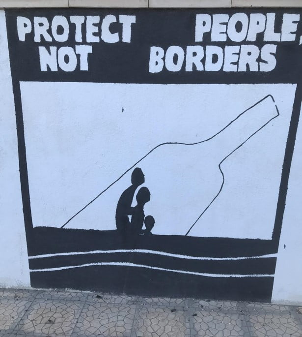 A sign in Lampedusa reading 'Protect people not borders'.