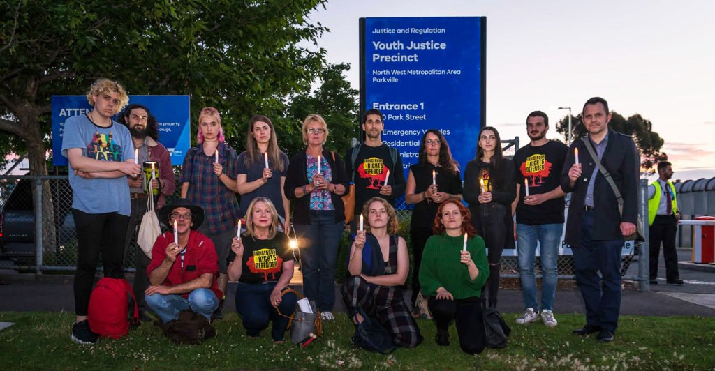 Amnesty activists attend a candlelit vigil outside a Youth Justice Precinct in Victoria as part of the Community is Everything Blitz
