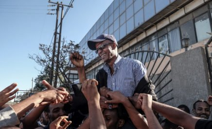 Ethiopian jounalist Eskinder Nega reacts with people after being released from Kaliti Prison in Addis Ababa on 14 February 14 2018.