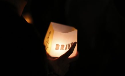 An illuminated lantern spelling brave at an Amnesty International Portugal stunt to free rights defenders in Turkey
